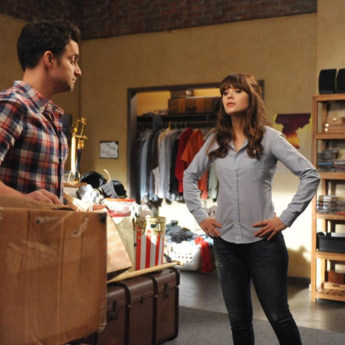 NEW GIRL: Nick (Jake Johnson, L) shows Jess (Zooey Deschanel, R) his box of unwanted responsibilities in the