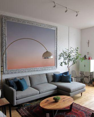 Here, the couple framed wallpaper for wall art.