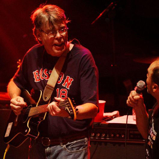NEW YORK - JUNE 1:  Authors Stephen King (L) and Scott Turow perform with the Rock Bottom Remainders at Webster Hall June 1, 2007 in New York City.  (Photo by Evan Agostini/Getty Images) *** Local Caption *** Stephen King;Scott Turow
