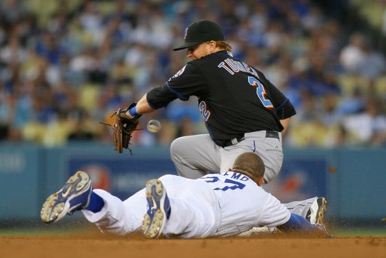 LOS ANGELES, CA - JULY 07:  Justin Turner #2 of the New York Mets misses the catch as Matt Kemp #27 of the Los Angeles Dodgers steals second base in the fourth inning during the MLB game at Dodger Stadium on July 7, 2011 in Los Angeles, California.  (Photo by Victor Decolongon/Getty Images)