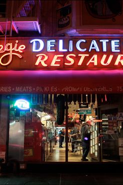 A night time exterior of the Carnegie Dellicatessen, a New York landmark restuarant established in 1937