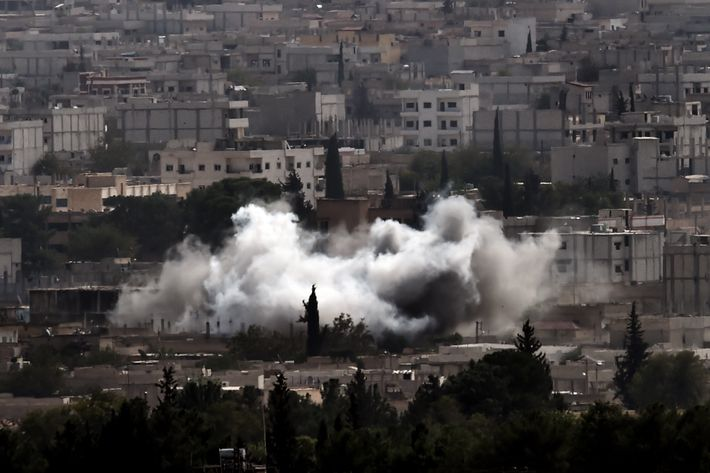 Smoke from shelling rises in the Syrian town of Ain al-Arab, known as Kobane by the Kurds, as it seen from the Turkish - Syrian border in the southeastern village of Mursitpinar, Sanliurfa province, on October 13, 2014.