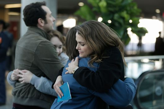 "THE AMERICANS -- ""March 8, 1983"" Episode 313 (Airs Wednesday, April 22, 10:00 PM e/p) Pictured: (l-r) Matthew Rhys as Philip Jennings, Holly Taylor as Paige Jennings, Keidrich Sellati as Henry Jennings, Keri Russell as Elizabeth Jennings. CR: Patrick Harbon/FX"