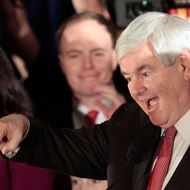 Republican presidential candidate, former Speaker of the House Newt Gingrich celebrates as he arrives for a primary night rally January 21, 2012 in Columbia, South Carolina.