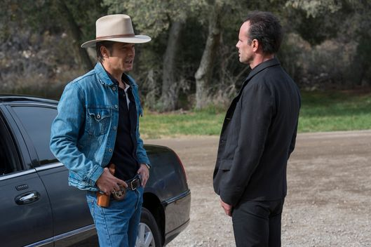 "JUSTIFIED -- ""Dark As a Dungeon"" -- Episode 608 (Airs Tuesday, March 10, 10:00 pm e/p) -- Pictured: (L-R) Timothy Olyphant as Deputy U.S. Marshal Raylan Givens, Walton Goggins as Boyd Crowder -- CR: Prashant Gupta/FX"