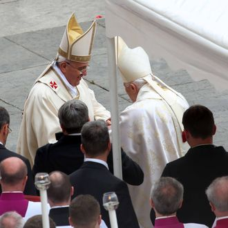 Pope Francis greets Pope Emeritus Benedict XVI at the end of the Canonization Mass in which John Paul II and John XXIII have been declared Saints on April 27, 2014 in Vatican City, Vatican. Dignitaries, heads of state and Royals from Europe and across the World are to attend the canonisations.