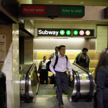 NEW YORK, NY - AUGUST 29:  Commuters walk to their subway August 29, 2011 in New York City. One day after Hurricane Irene hit New York the mass transit system, including subways and buses, began moving again in a limited capacity in time for Monday's rush hour.  (Photo by Joe Raedle/Getty Images)