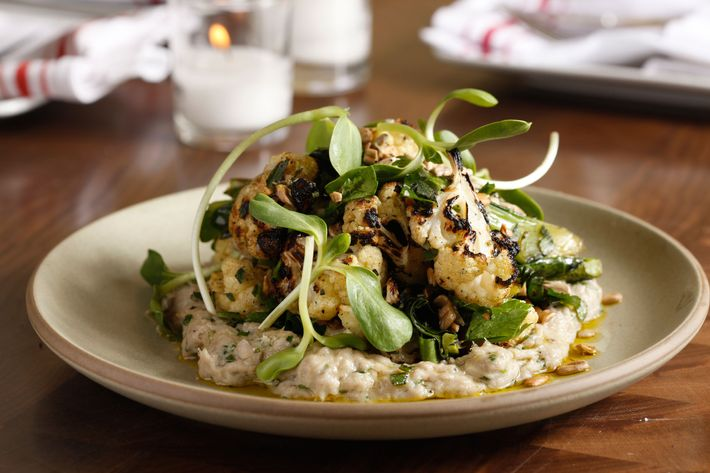 Grilled cauliflower with smoked bluefish and sunflower seeds.