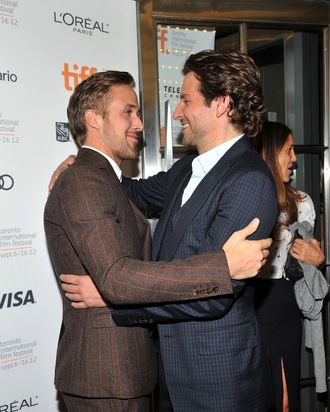 Actors Ryan Gosling (L) and Bradley Cooper attend