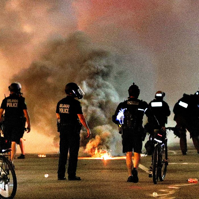 Police deploying tear gas amid Black Lives Matter protests in Los Angeles.