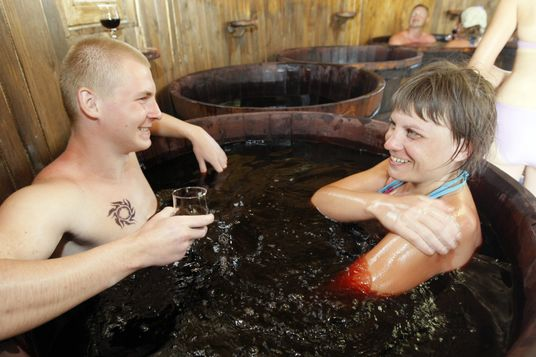 A couple taking a wine spa bath in the wine spa center (a vinotherapy resort) at the Golden Beach (Zolotoi Plyazh) recreation center.