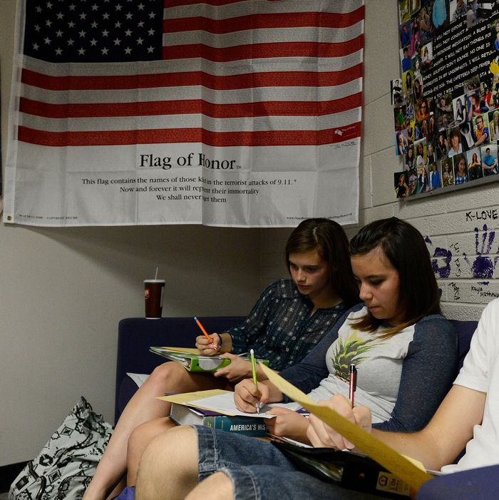 WHEAT RIDGE, CO. - SEPTEMBER 25: Wheat Ridge High School students from left to right, Jana McVey, 15, Michaela Zavala, 14, and Chay Martin, 15, work on classwork in Stephanie Rossi's sophomore AP U.S. History class Thursday afternoon, September 25, 2014. Their teacher, Stephanie Rossi, is against the Jefferson County School board member's proposal to change the AP U.S. History curriculum which includes promoting patriotic material, respect for authority and the free-market system and avoiding material about civil disorder, social stripe and disregard for the law. (Photo By Andy Cross / The Denver Post)