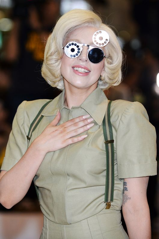 US pop music star Lady Gaga poses for photographers upon her arrival at Narita Airport, outside Tokyo on November 26, 2013. Lady Gaga is in Japan to promote her latest album 'ARTPOP'.