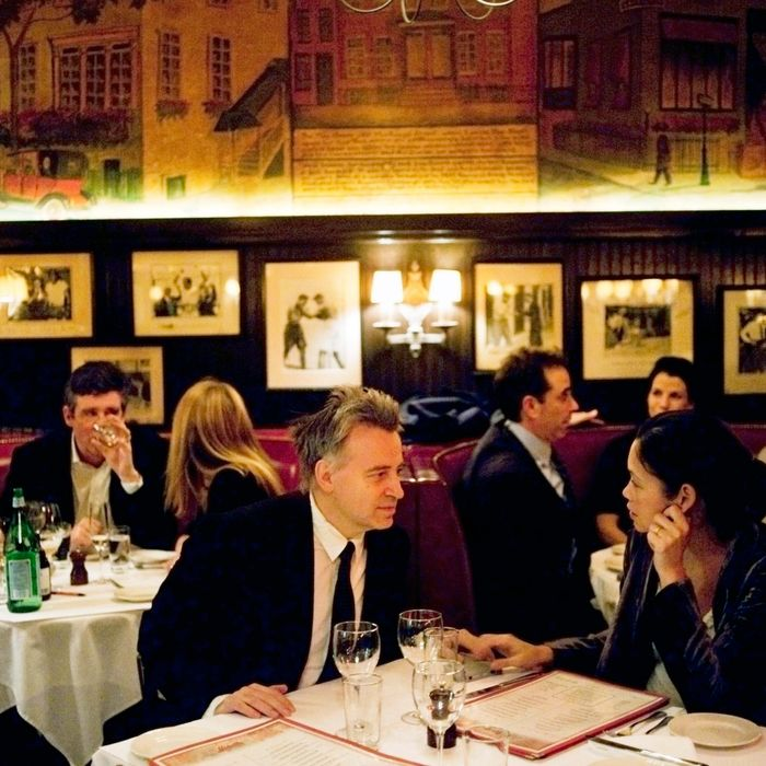 Keith McNally, Brooke Shields, Jay McInerney, Jerry Seinfeld, and George Stephanopoulos all sit in the back dining room at Minetta Tavern.