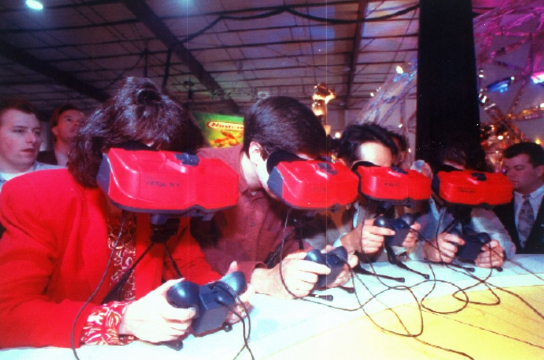 Customers using headgear & controls to test Nintendo's Virtual Boy video game at 1995 Winter Consumer Electronics Show.  (Photo by Marty Katz//Time Life Pictures/Getty Images)