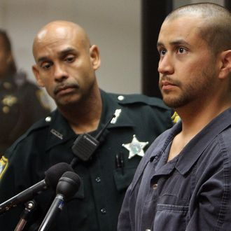 George Zimmerman (R) appears for a bond hearing at the John E. Polk Correctional Facility April 12, 2012 in Sanford, Florida.
