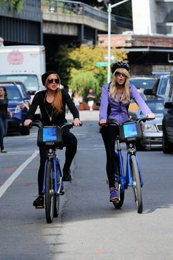 Actress Lindsey Lohan and her mother Dina Lohan ride Citibikes up the Westside Highway in New York City.