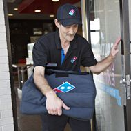 New York Accuses Domino's of Helping Franchisees Steal Workers' Wages