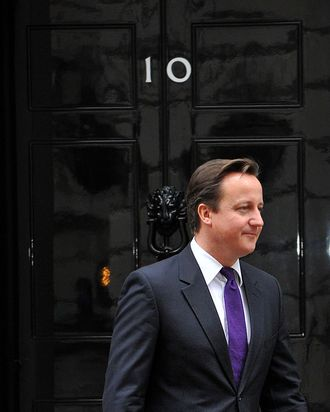 British Prime Minister David Cameron is pictured at the front door of 10 Downing Street in London, on November 16, 2011, as he awaits the arrival of Serbian President Boris Tadic. The Bank of England on Wednesday cut its forecasts for British economic growth, saying the