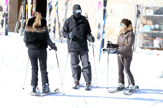 30 Dec 2013, Los Angeles, California, USA --- Kim Kardashian, sister Kourtney and a figure, thought to be Kanye West go skiing in, Utah. Kim, dressed all in black lead the way to the chair lift while their friend, in an all black ski mask lagged behind. Pictured: Kim Kardashian --- Image by ? Splash News/Splash News/Corbis