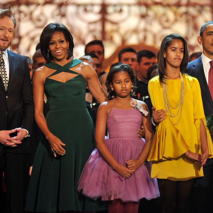 The Obamas with the event's host, Conan O'Brien.