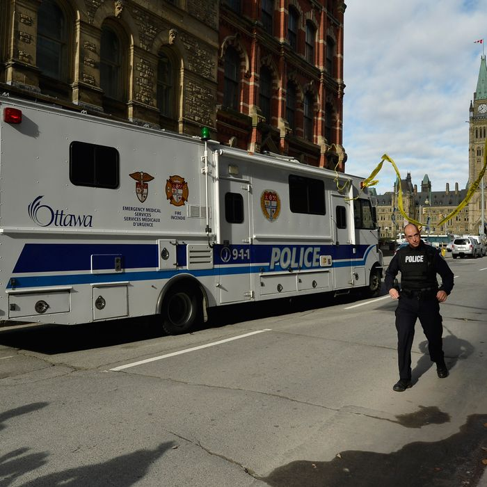 Police block off access to Parliament Hill after shots were fired on Wednesday Oct. 22, 2014 in Ottawa.