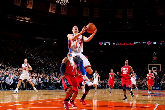 NEW YORK, NY - FEBRUARY 20:  Jeremy Lin #17 of the New York Knicks drives to the basket against Sundiata Gaines #1 of the New Jersey Nets on February 20, 2012 at Madison Square Garden in New York City.  NOTE TO USER: User expressly acknowledges and agrees that, by downloading and or using this photograph, User is consenting to the terms and conditions of the Getty Images License Agreement. Mandatory Copyright Notice: Copyright 2012 NBAE  (Photo by Nathaniel S. Butler/NBAE via Getty Images)