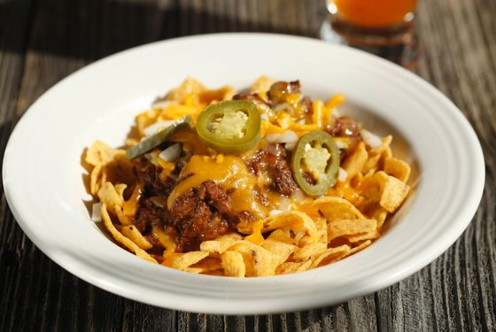 Frito Pie: Fritos topped with Texas red chili, cheese, onions and pickled jalapeños.