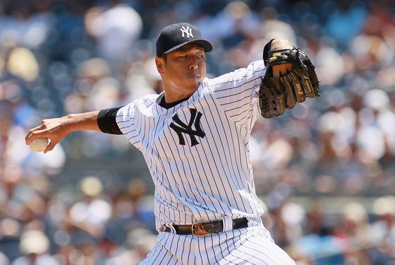 NEW YORK, NY - JUNE 30: Hiroki Kuroda #18 of the New York Yankees pitches in the first-inning against the Chicago White Sox at Yankee Stadium on June 30, 2012 in the Bronx borough of New York City.  (Photo by Mike Stobe/Getty Images)
