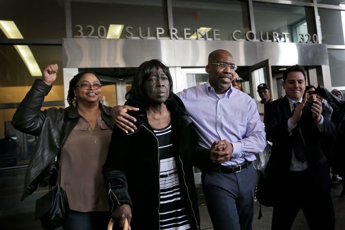 Jonathan Fleming, second from right, exits the courthouse with his mother Patricia Fleming, second from right, in New York, Tuesday, April 8, 2014. Jonathan Fleming, who spent almost a quarter-century behind bars for murder, was freed in New York City on Tuesday and cleared of a killing that happened when he was 1,100 miles away on a Disney World vacation. (AP Photo/Seth Wenig)