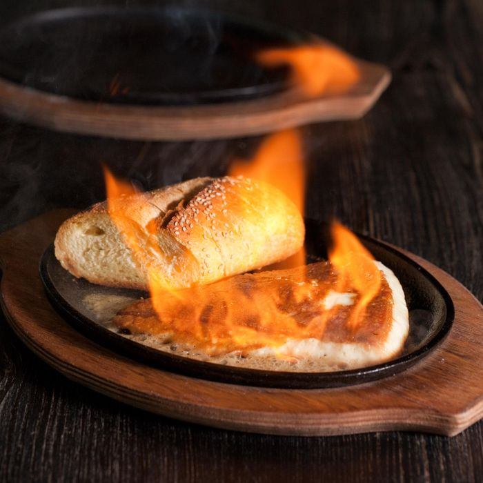 Ed and Bev's saganaki gets real crispy.