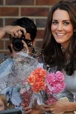 Britain's Catherine, the Duchess of Cambridge, meets wellwishers as she leaves with her husband Prince William (not pictured) after opening a children's cancer unit at the Royal Marsden Hospital in Sutton, in south-east England, on September 29, 2011. AFP PHOTO/BEN STANSALL (Photo credit should read BEN STANSALL/AFP/Getty Images)