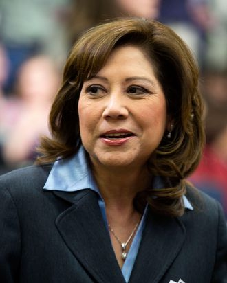 Secretary of Labor Hilda Solis arrives prior to U.S. President Barack Obama's address the White House Forum on ''Women and the Economy'' in the Eisenhower Executive Office Building on April 6 2012 in Washington, DC. Obama highlighted ways the Administration has helped create economic security for women and recognized that women are key to economic growth and competitiveness.