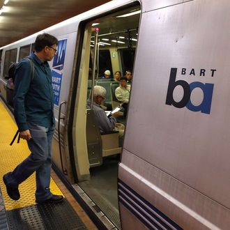 A Bay Area Rapid Transit (BART) passenger boards a train on October 15, 2013 in San Francisco, California.