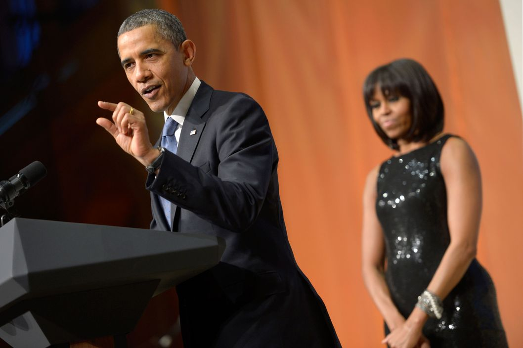 U.S. President Barack Obama, with First Lady Michelle Obama, delivers remarks at the Inaugural Reception at the National Building Museum on January 20, 2013 in Washington, D.C. Obama defeated Republican candidate Mitt Romney on Election Day 06 November 2012 to be re-elected for a second term.