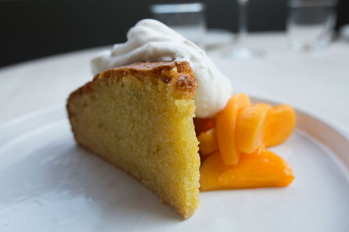 Olive-oil cake with persimmon, grappa, and honey whipped cream.