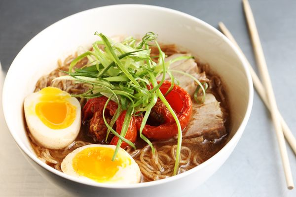Ivan Ramen's classic shio, with rye noodles, roasted tomato, and pork chashu.