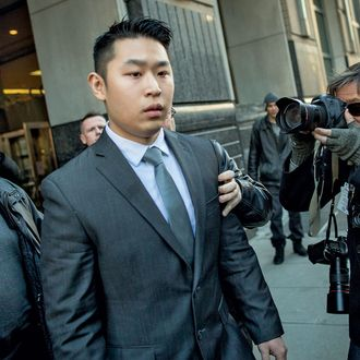 New York City Police (NYPD) officer Peter Liang (C) departs the criminal court after an arraignment hearing in the Brooklyn borough of New York City February 11, 2015. The New York City rookie police officer was charged with manslaughter in the second degree and five other offenses on Wednesday for the fatal shooting of an unarmed man in the darkened stairwell of a housing project last November. REUTERS/Brendan MCDermid (UNITED STATES - Tags: CRIME LAW) - RTR4P81A