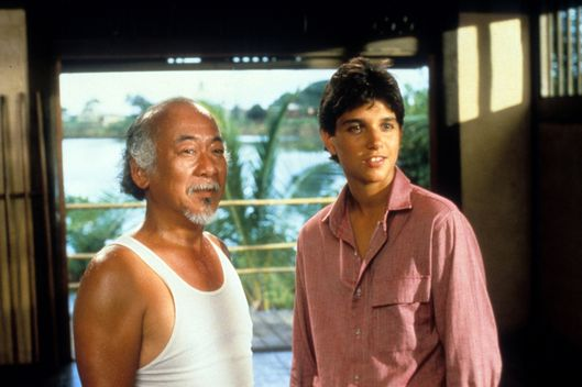 Pat Morita and Ralph Macchio in a scene from the film 'The Karate Kid', 1984. (Photo by Columbia Pictures/Getty Images)