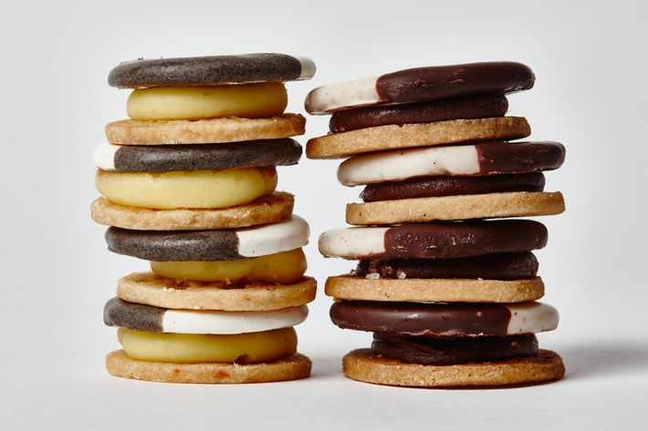 """Eleven Madison Park's """"black and whites"""" are actually Cheddar shortbread with white-butter and black-vegetable-ash glazes (at left), and oatmeal shortbread with apple filling and chocolate glaze."""