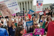 Demonstrator react to hearing the Supreme Court's decision on the Hobby Lobby case outside the Supreme Court in Washington, Monday, June 30, 2014. The Supreme Court says corporations can hold religious objections that allow them to opt out of the new health law requirement that they cover contraceptives for women.(AP Photo/Pablo Martinez Monsivais)