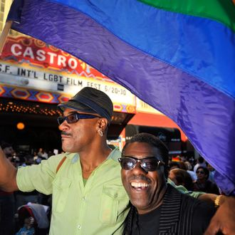 Troy Brunet (L) waves a flag as celebrations ensue in the Castro neighborhood of San Francisco, California, June 26, 2012, after the US Supreme Court struck down The Defense of Marriage Act (DOMA), and declared that same-sex couples who are legally married deserve equal rights to the benefits under federal law that go to all other married couples. In another ruling, the Supreme Court cleared the way for same-sex marriages to resume in California as the justices, in a procedural ruling, turned away the defenders of Proposition 8.