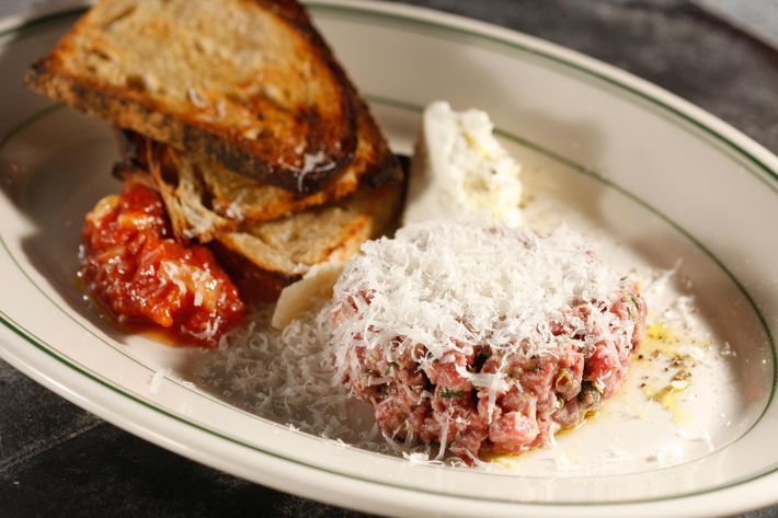 The meatball tartare incorporates traditional ingredients from the Italian-American classic including chives and parsley for seasoning along with ricotta and red sauce on the side.