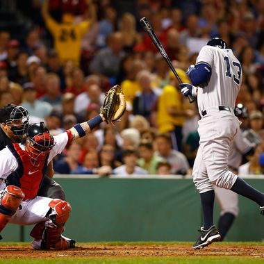 BOSTON, MA - AUGUST 18: Alex Rodriguez #13 of the New York Yankees is hit by a pitch in the second inning by Ryan Dempster #46 of the Boston Red Sox during the game on August 18, 2013 at Fenway Park in Boston, Massachusetts. Both benches were immediately warned and manager Joe Girardi #28 of the New York Yankees was ejected by umpire Brian O'Mora. (Photo by Jared Wickerham/Getty Images)