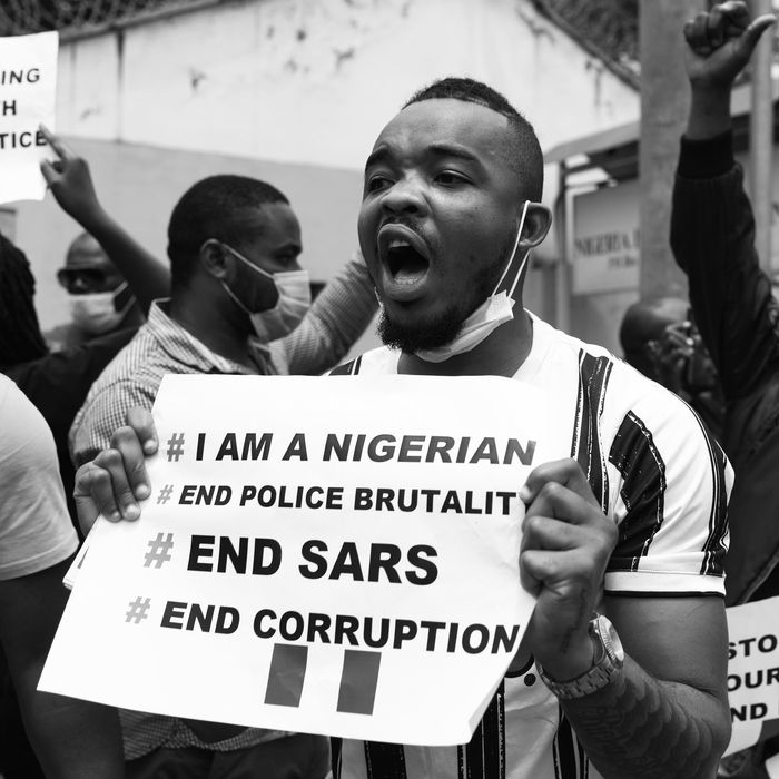 An #EndSars protester outside the Nigerian embassy in Nairobi.