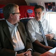 IN FLIGHT - OCTOBER 31:  Republican presidential candidate, former Massachusetts Gov. Mitt Romney (R) talks with former Florida Gov. Jeb Bush aboard his campaign plane on October 31, 2012 en route to Miami, Florida. With less than one week to go until election day, Mitt Romney is campaigning throughout Florida.  (Photo by Justin Sullivan/Getty Images)