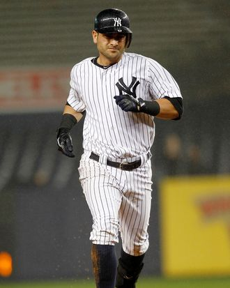 Fancisco Cervelli of the New York Yankees rounds the bases on his solo home run in a game against the Baltimore Orioles at Yankee Stadium on September 6, 2011.