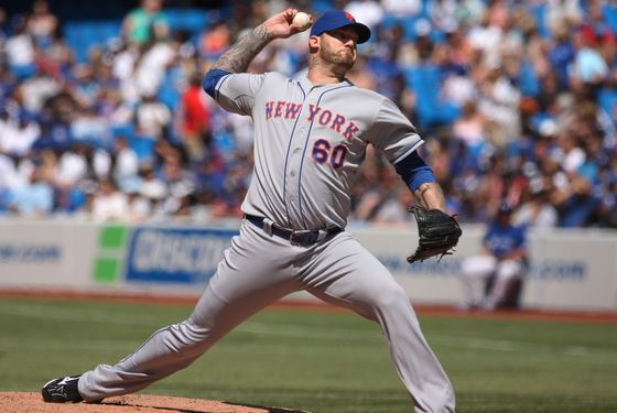 TORONTO, CANADA - MAY 19: Jon Rauch #60 of the New York Mets delivers a pitch during MLB game action against the Toronto Blue Jays on May 19, 2012 at Rogers Centre in Toronto, Ontario, Canada. (Photo by Tom Szczerbowski/Getty Images)