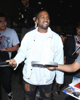Yeezy surrounded by the daily swarm.