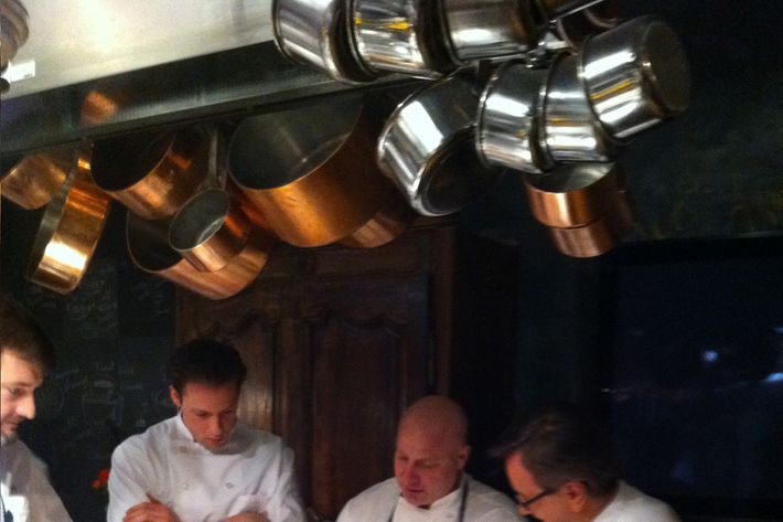 Colicchio cooking alongside foodie-Olympian Garrett Weber-Gale and Daniel Boulud.